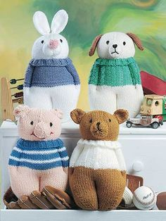 """Give the baby shower gift that will steal the show!   These knit stuffed toys, the latest needlecraft trend, will delight young and old alike. Choose from 6 adorable animal designs including a cat, dog, pig, bear, rabbit and elephant. They're perfect gifts for baby showers, birthdays and holidays! Knit with worsted-weight yarn using U.S. size 8/5mm needles. Each animal is approximately 8 1/2""""W x 12""""H."""