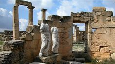 File photograph of statues and ruins at Cyrene, where UNESCO say bulldozers have started encroaching on ancient sites.