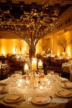 Sophisticated New York Wedding with Warm Amber Lighting from Brian Dorsey Studios - wedding centerpiece.