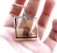 photo on transparencies cast in resin [Etsy: bethtastic]....inspiration