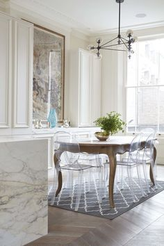 Antique table with lucite chairs | Old Meets New in Notting Hill | lark and linen I want this in black