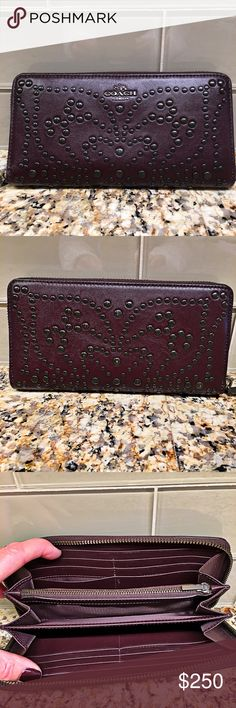 Coach wallet with mini studs in Oxblood Coach studded Oxblood leather accordian zip around wallet. Wallet has 12 credit card slots, 2 full length bill compartments, 1 coin zipper pocket, 3 large expandable slip pockets, textured leather and nylon interior. Lovingly used a few times and in excellent condition. I also have the matching bag available Coach Bags Wallets