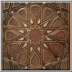 Geometrical pattern of stars and interlaced multi-sided polygons on a wooden panel on display in Museum of Islamic Art. Doha, Qatar