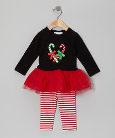 This sweet little set is what every girl dreams of, and then some. The playful candy cane appliqué and tulle skirting on the tutu dress set the stage for a great day, while the cozy leggings bring the whole special ensemble together.Includes dress and leggingsBodice: 95% cotton / 5% spandexSkirt: nylon / polyesterLeggings: 95% cotton / 5% spandexMachine washImported