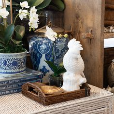 Rattan tray with decor items on.