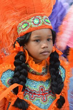 Mardi Gras Indian on Super Sunday 2012  Photo from the Super Sunday Mardi Gras Indian Festival in and around A.L. Davis Park in New Orleans, Louisiana on Sunday, March 18, 2012. Photo by Kim Welsh. - I'm not 100% sure, but she looks Melungeon.