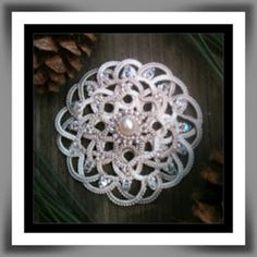 "Original needle tatted pendant design made using Valdani Luxury Pearl silk in S49, ""Subtle Elegance""."