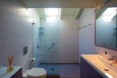 Modern bathroom with rain shower...