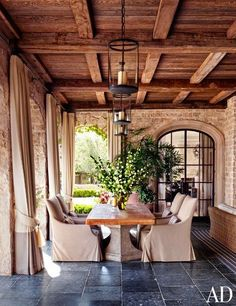 Love the warm color of the beams in this outdoor space