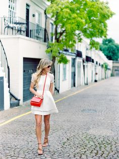 little white dress + red bag.