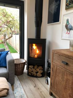 Here we have the installation of a: - Dik Guerts Folke Freestanding Wood Burning Stove with Log Store Corner Log Burner, Wood Burning Stove Corner, Log Burning Stoves, Modern Wood Burning Stoves, Wood Stoves, Modern Log Burners, House Extension Design, House Design, Design Design