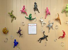 Wall of Ancizar Marin's Colorful Climbers   888-264-4887   Metro Detroit Art Gallery