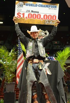 J.B. Mauney, from Mooresville, NC, USA holds up his $1,000,000 check for winning the 2013 World PBR Championship. In addition, he won the 2013 PBR Finals Week Event riding Wipeout for a score of 93 points at the Thomas and Mack Arena in Las Vegas. Sunday, October 27, 2013. (Photo/Las Vegas News Bureau, Glenn Pinkerton) Rodeo Cowboys, Real Cowboys, Lane Frost, Rodeo Events, Professional Bull Riders, Nc Usa, Las Vegas Photos, Rodeo Life, Finals Week