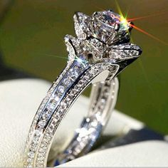 Round Cut Floral Style White Diamond Engagement Ring from Taj Jewels