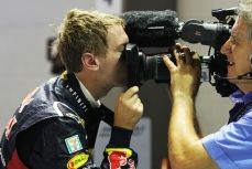Sebastian Vettel of Red Bull Racing kisses the camera after coming in first at the 2012 FORMULA 1 SINGTEL SINGAPORE GRAND PRIX