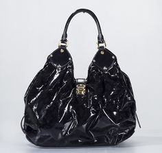 ddb8dcec995 Made from black patent leather this bag features the Louis Vuitton monogram  pattern created by perforations on the leather. There are two rolled  leather ...