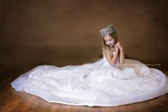 5 year old in mothers wedding dress in galion ohio photography studio