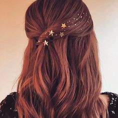 New hair trend alert! These cute hair gems are perfect for glitzing up any outfit, any time, day or night. We simply love the star gems on this loose, half up 'do!