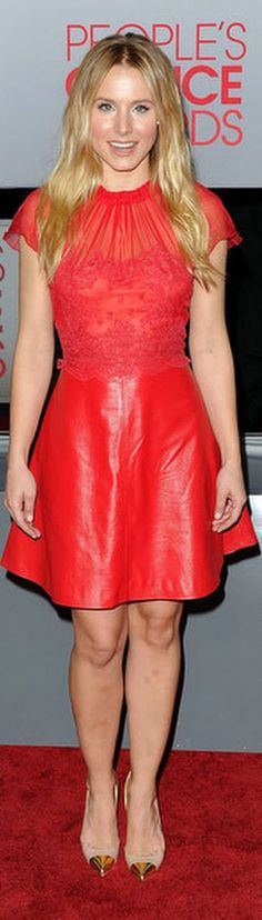Red Carpet fashion dress - Kristen Bell was sweet in a scarlet dress leather & lace Valentino dress with gold tipped Louboutin pumps.