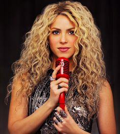 Love Shakira's hair! Can't wait till mine is this long.