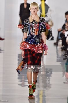 A model walks the runway at the Margiela Winter 2016 fashion show during Paris Fashion Week on March 2, 2016 in Paris, France.