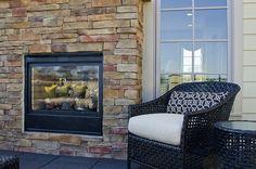 A dual-sided fireplace..need I say more?! #ModelHome