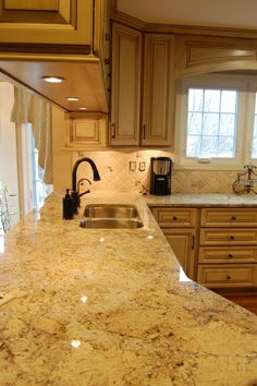 The floor shown, against the light wood cabinets with a beige-ish countertop. Like these colors