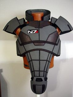 For larp play it would need the logo removed, or obscured. Unless it was actually a Mass Effect larp. Ninja Armor, N7 Armor, Helmet Armor, Sci Fi Armor, Suit Of Armor, Body Armor, Cosplay Armor, Cosplay Diy, Robot Costumes