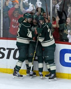 Apr 28, 2014; Saint Paul, MN, USA; Minnesota Wild forward Zach Parise (11) celebrates his goal with defenseman Jonas Brodin (25) and forward Charlie Coyle (3) during the third period against the Colorado Avalanche in game six of the first round of the 2014 Stanley Cup Playoffs at Xcel Energy Center. The Wild defeated the Avalanche 5-2. Mandatory Credit: Brace Hemmelgarn-USA TODAY Sports