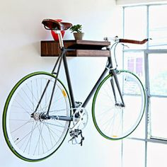 What a STYLISH way to store your bike! The Bike Shelf $299 Knife & Saw This is an absolutely beautiful solution to bike storage and not much else needs to be said. Designed and made by Chris Brigham in San Francisco out of either walnut or ash