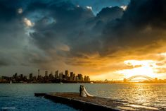 In October photographer Sam Yeldham set up his camera to capture a Turneresque Sydney sunset when these newlyweds joined the frame. Through social media, he was able to identify the couple and gift them with an unexpected wedding present. Wedding Tips, Wedding Couples, Wedding Day, Budget Wedding, Wedding Ceremony, Wedding Attire, Wedding Themes, Wedding Dresses, Wedding Details