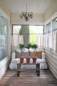 Our first house had a little porch on the front like this.I loved that house and always had visions of putting cafe curtains up. Enclosed Front Porches, Small Screened Porch, Small Sunroom, Estilo Country, Sleeping Porch, Floor Sleeping, Building A Porch, Marquise, House With Porch