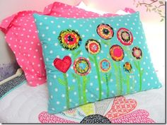 DIY custom pillow decorated with circle flowers