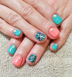 Turquoise and coral go great together in this mani!