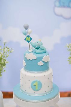Loving this Elephant themed 1st birthday cake at this little boys party! So cute!! See more party ideas and share yours at CatchMyParty.com #catchmyparty #elephant #1stbirthday