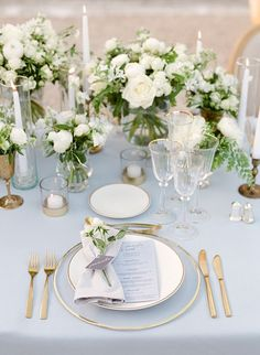A Chic, Family-Oriented Destination Wedding in France The delicate place settings included glass chargers, matte gold cutlery, tulip-shaped glasses, and. Wedding Table Decorations, Wedding Centerpieces, Blue Centerpieces, Gold Table Decor, Centerpiece Flowers, Masquerade Centerpieces, Quinceanera Centerpieces, Table Flowers, Flower Arrangements