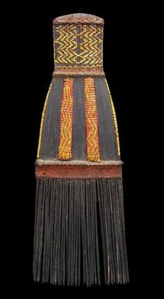 A faa, or man's woven comb from the Kwaio People, Malaita, Solomon Islands. Woven from yellow-orchid and coconut-palm-frond fibres, the comb was dyed with the geru root. Its teeth are made of fern wood.
