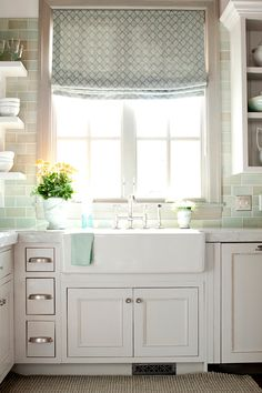 farmhouse sink + aqua subway tile + roman shade