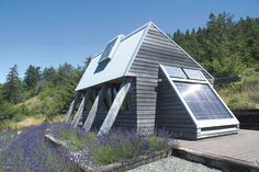 two solar panels, one remotely located, provide all the electricity needs for this small garden cottage on the Oregon coast