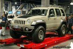 This is what my Jeep Liberty would look like when I put my big tires on it but it would look better because my jeep is black and has a better grill! Jeep 4x4, Old Jeep, Jeep Pickup, Jeep Truck, Jeep Liberty Lifted, 2006 Jeep Liberty, Jeep Liberty Renegade, Jeep Renegade, Jeep Grand Cherokee