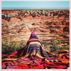 Splendid layers of blankets against an equally idyllic painted desert scene.