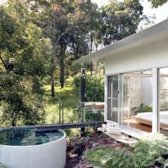This prefabricated mountainside home in Australia comes complete with a plunge pool just off the master bedroom retreat!