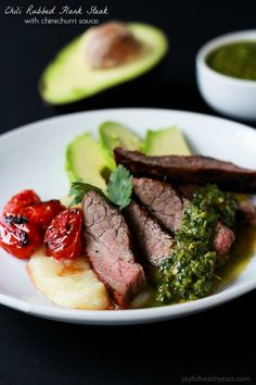 Healthy + Easy Chili Rubbed Flank Steak served with fresh chimichurri sauce, done in 30 minutes. Soooo stinking good! | www.joyfulhealthyeats.com #recipes #eathealthy #glutenfree #paleo