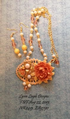 Rose from B'Sue painted with Lumiere Halo Rose Pink - I love that color!.Back plate from B'Sue base painted white then added Mandarin Perfect Pearls. Small floral cameo another one painted in the 70's by my talented aunt. B'Sue pearl cabs and vintage pearls & beads from my stash.