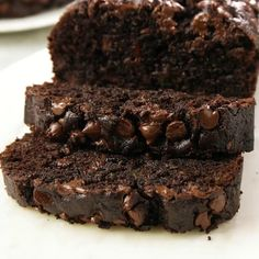 This easy Chocolate Zucchini Bread recipe is moist, chocolaty, and will remind you of your favorite chocolate cake. You don't have to feel guilty about eating a sweet treat when zucchini is involved because you are eating a vegetable! Vegan Zucchini Recipes, Zucchini Bread Muffins, Gluten Free Zucchini Bread, Chocolate Chip Zucchini Bread, Healthy Bread Recipes, Moist Banana Bread, Banana Bread Recipes, Gourmet Recipes, Baking Recipes
