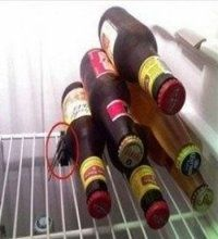 Use binder clips to keep stacked bottles in place in the fridge