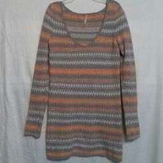 Free People Zig Zag Stripe Long Sweater Wear this as a dress or sweater!  Grey, orange, white chevron zig zag stripe.  Crew neck.  Cotton, poly, acrylic blend.  Excellent Used Condition. Free People Sweaters Crew & Scoop Necks