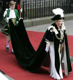 Queen Elizabeth II, assisted by a Page of Honour, arrives at St Giles Cathedral for the Order of Thistle Ceremony on 7 July 2006