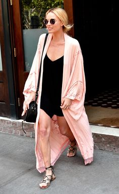 Margot Robbie in a pink kimono and black silk slip, perfect for summer.