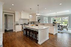 Kitchen | Breakfast Area | Class Chic Stye Custom Home | Kitchen Island | Super White Granite Countertop | White Kitchen Cabinets | Hardwood Floors | Recessed Lighting | Smart Builders, Inc.
